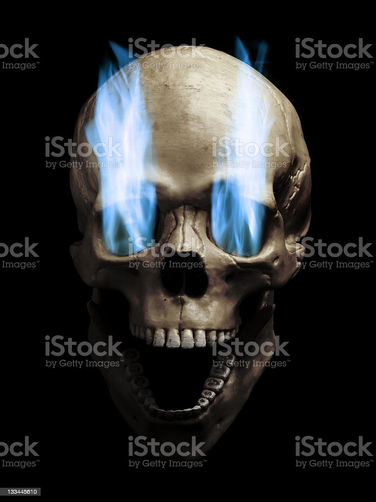 Skull with flaming eyes stock photo