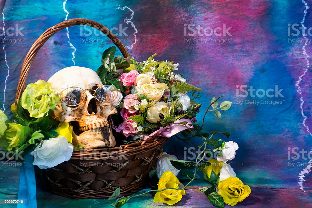 Skull with flowers and wine. stock photo
