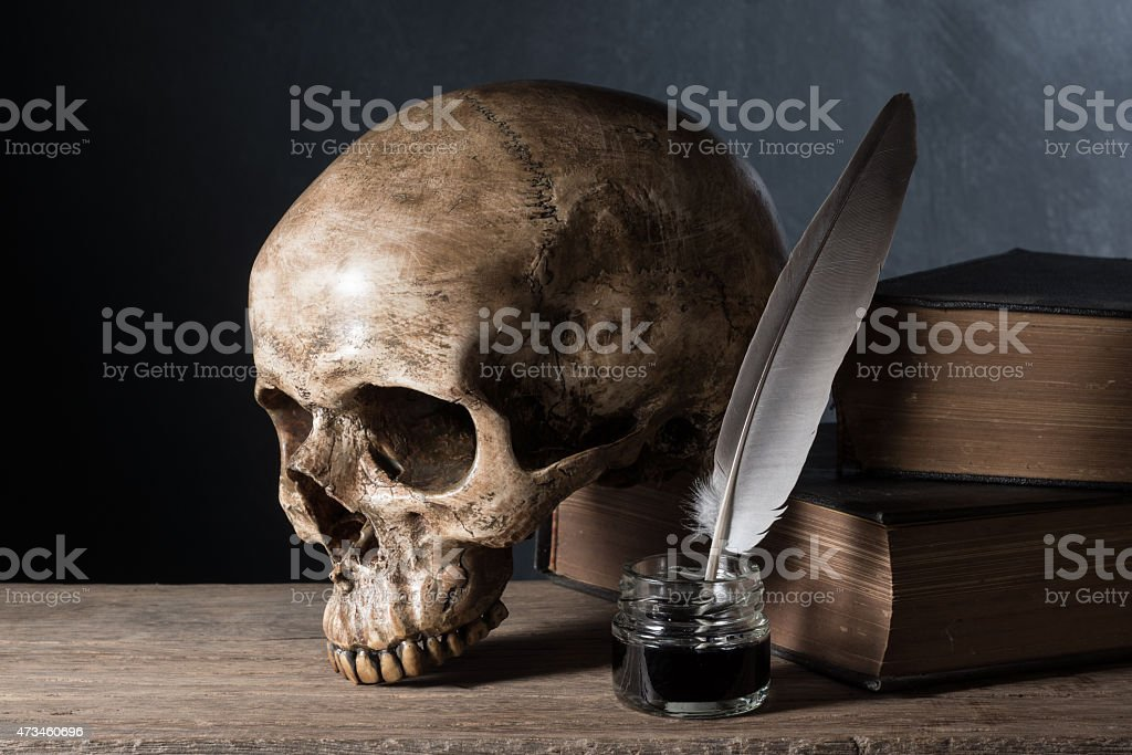 skull with inkwell stock photo