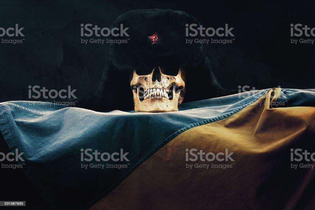 Skull with russian Ushanka on the ukraine Flag stock photo