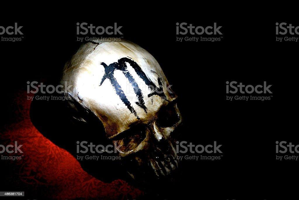 Skull with Zodiac Scorpio Mark stock photo