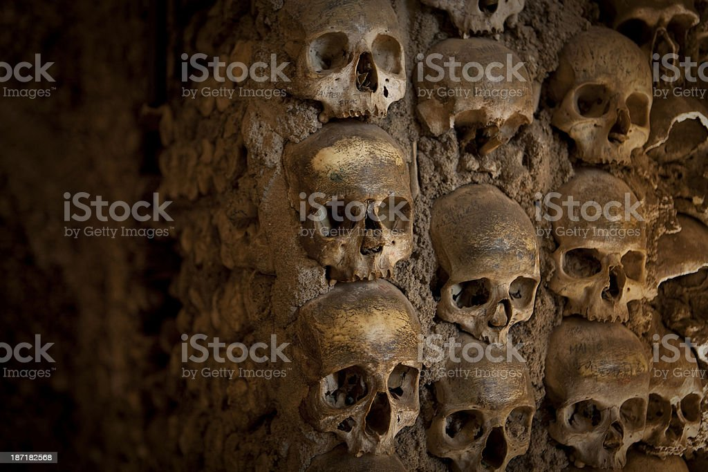 Skulls embedded into a wall royalty-free stock photo