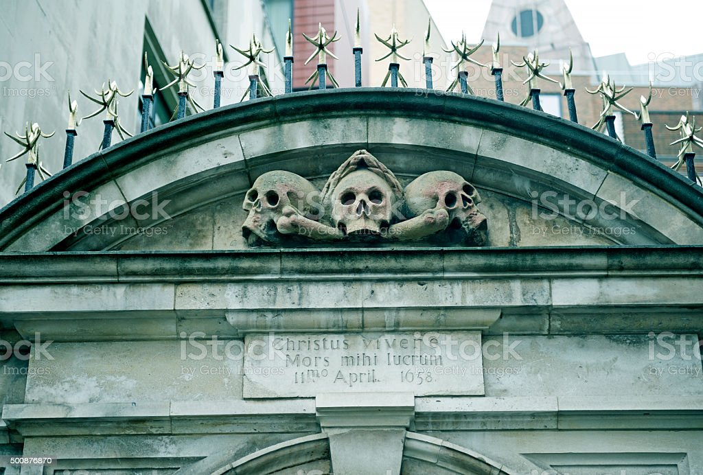Skulls on gate from 1658 in London England stock photo