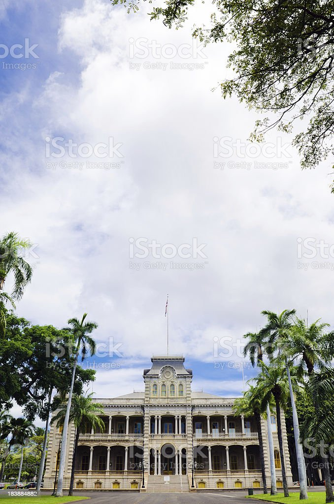 Sky above Iolani Palace and palm trees in Honolulu, HI stock photo