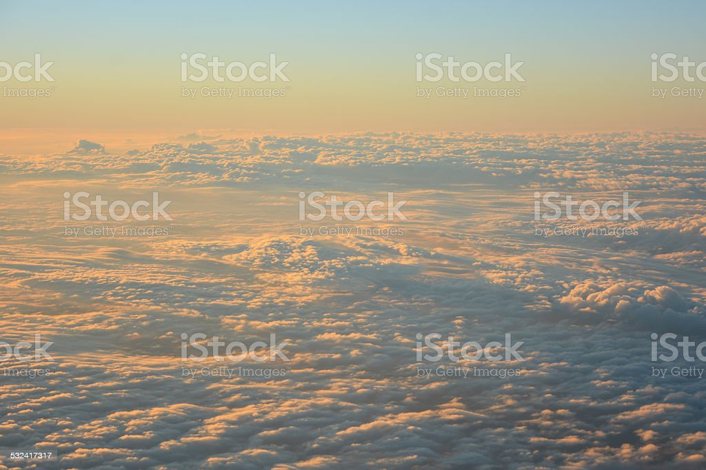 Sky and clouds in the evening taken from airplane stock photo