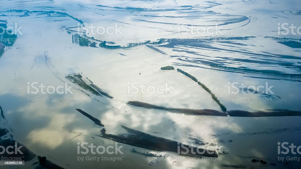 Sky and clouds reflected in river with woods stock photo