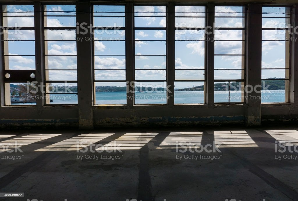 sky and clouds through window of an abandoned building stock photo