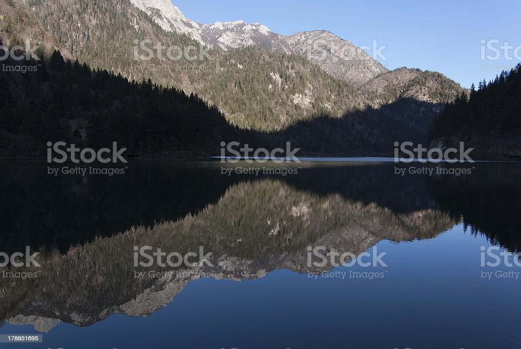Sky and mountain reflect in the lake royalty-free stock photo