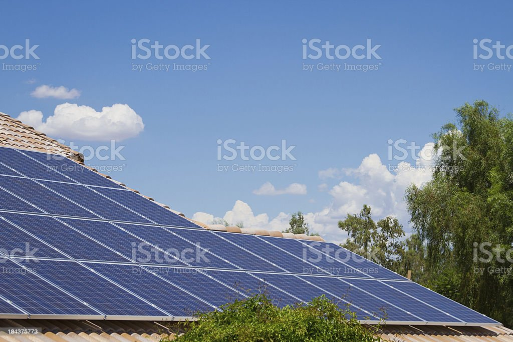 Sky and Solar Panels on Tile Roof royalty-free stock photo