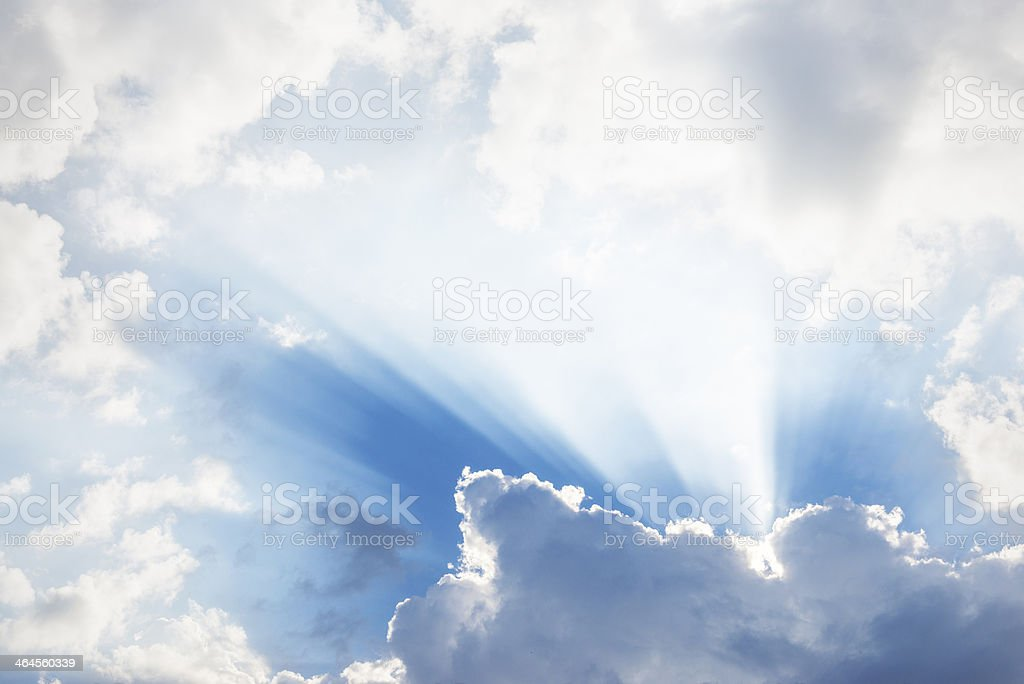 sky and sun rays between clouds stock photo