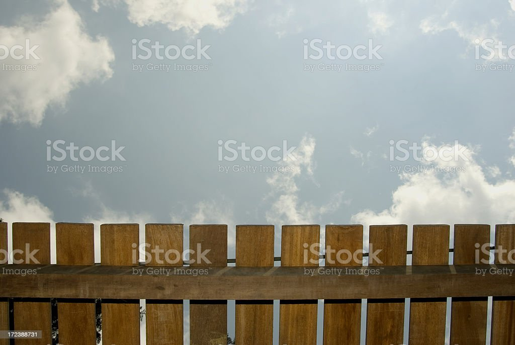 Sky behind the fence royalty-free stock photo