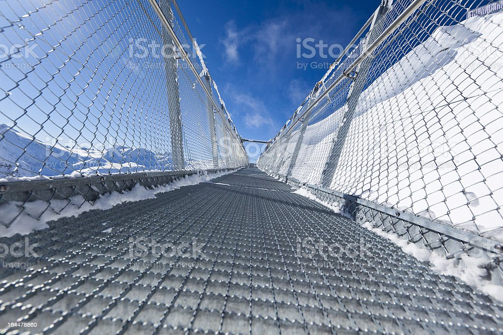 sky bridge over the swiss alps stock photo