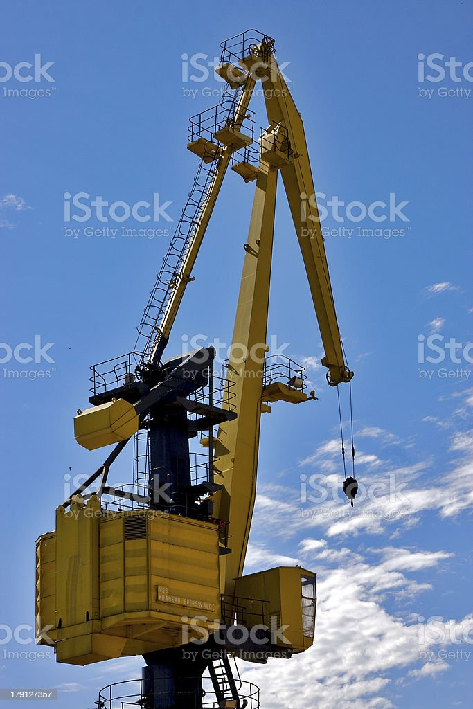 sky clouds and yellow crane in   argentina royalty-free stock photo