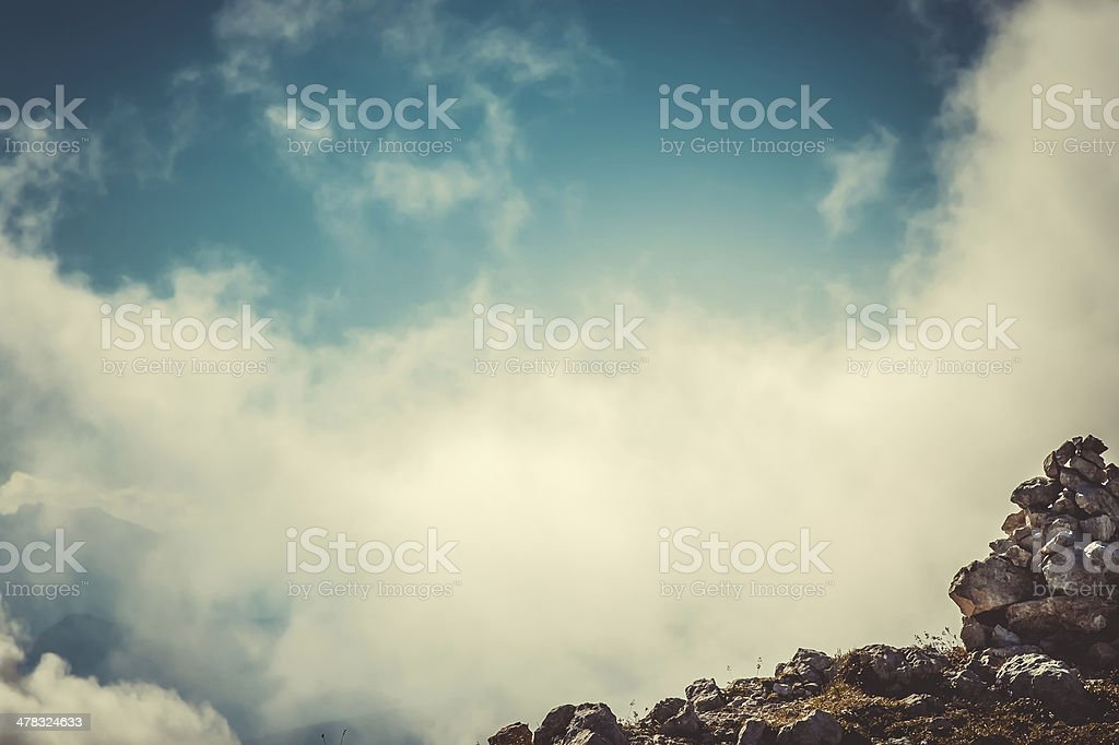 Sky Clouds on Mountain summit with stones hiking route royalty-free stock photo