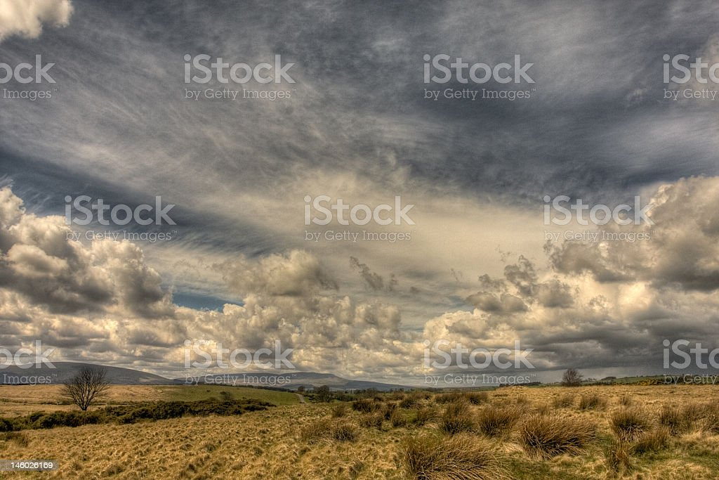 Sky detail above rugged land stock photo
