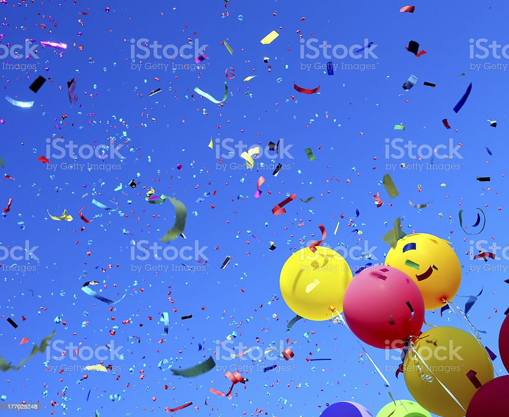 A sky full of confetti and a bunch of balloons royalty-free stock photo