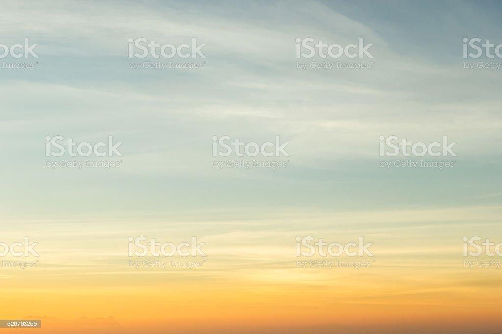 Sky gradient from blue to orange stock photo