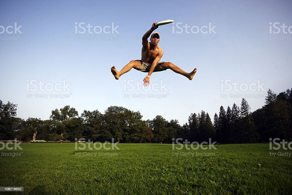 Sky High Frisbee Guy royalty-free stock photo