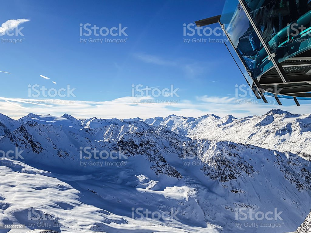 Sky Hotel overlooking on Alps mountains stock photo