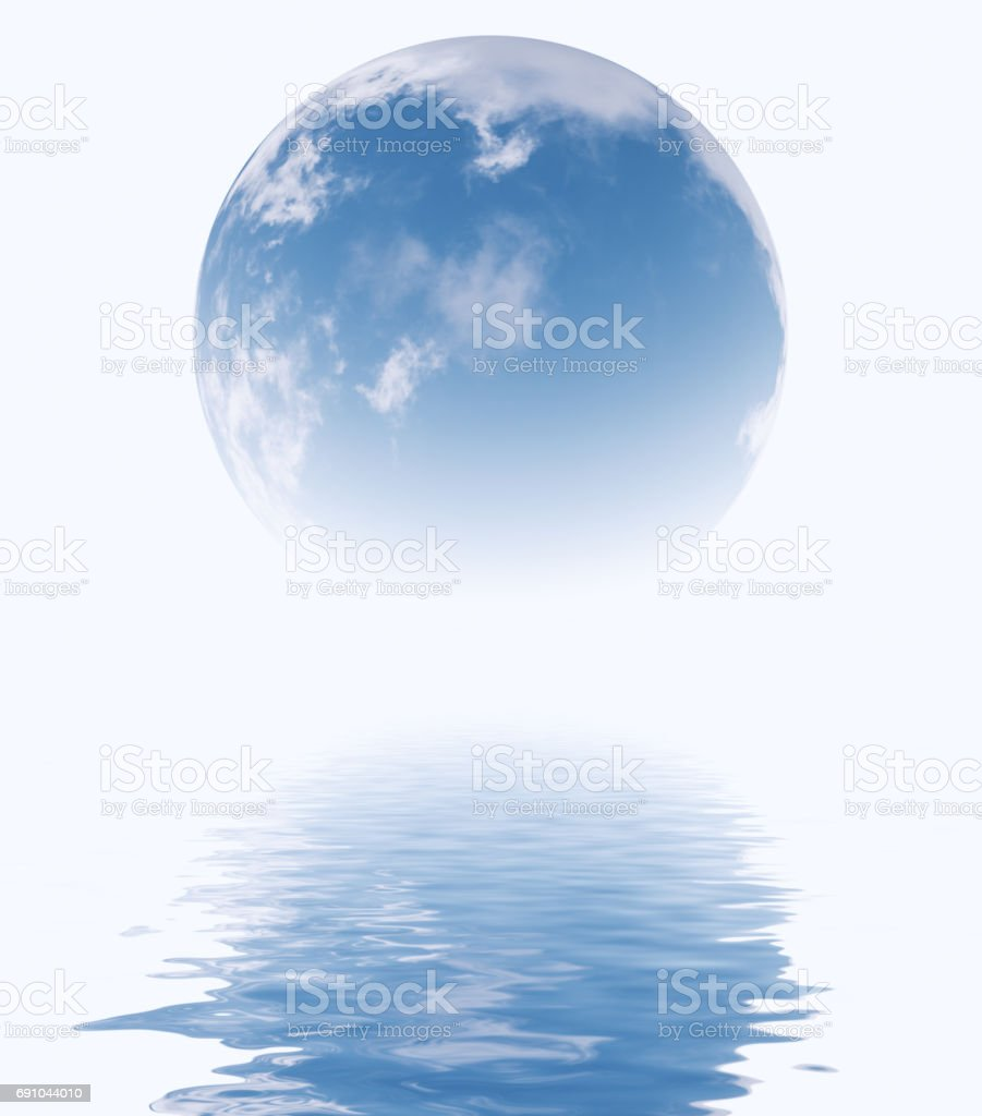 Blue sky in glass sphere reflecting in water surface.