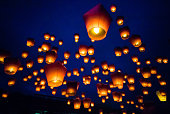 Sky lanterns against the sky with blue tone