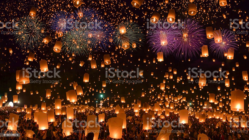Sky lanterns with fireworks stock photo