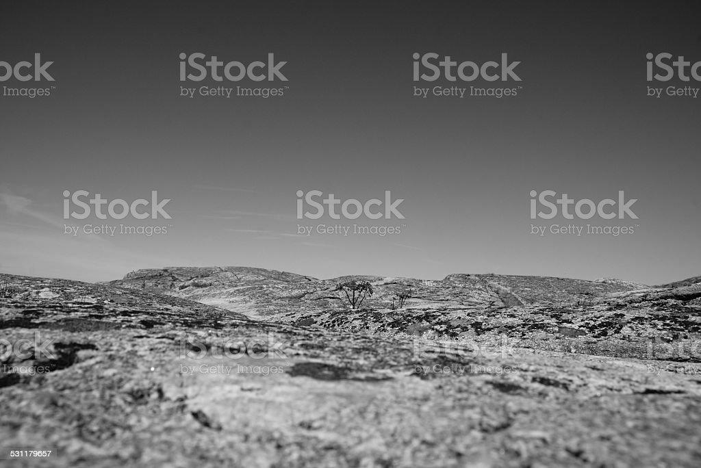 Sky meets rock stock photo