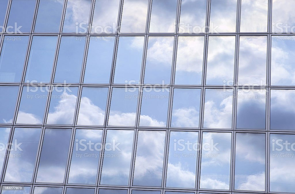 Sky reflecting in office building royalty-free stock photo