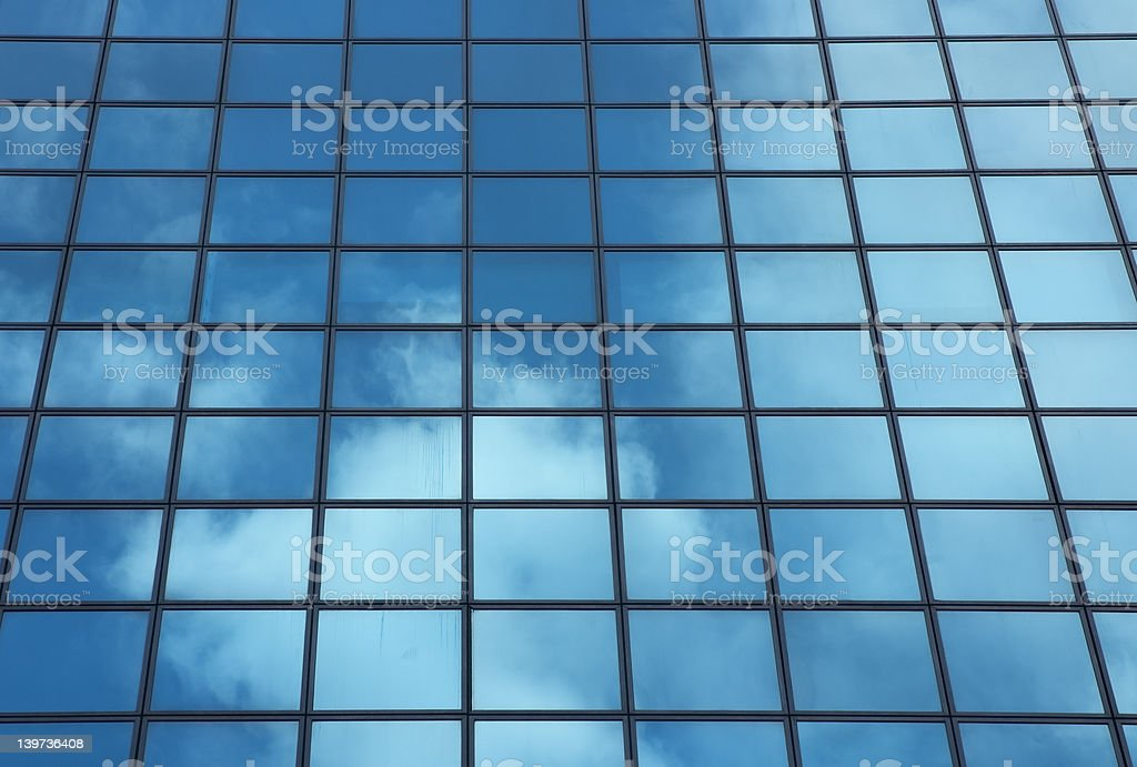 sky reflecting in windows of office building royalty-free stock photo