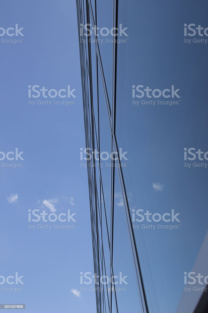 Sky reflecting off a building stock photo