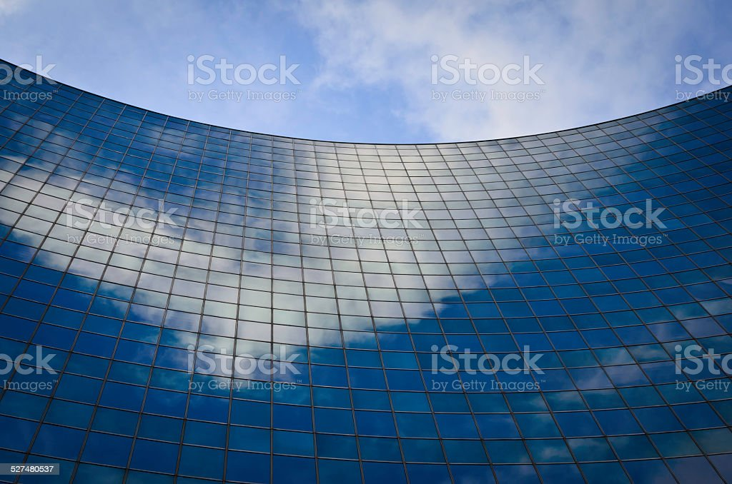 sky reflection on modern curved office building royalty-free stock photo