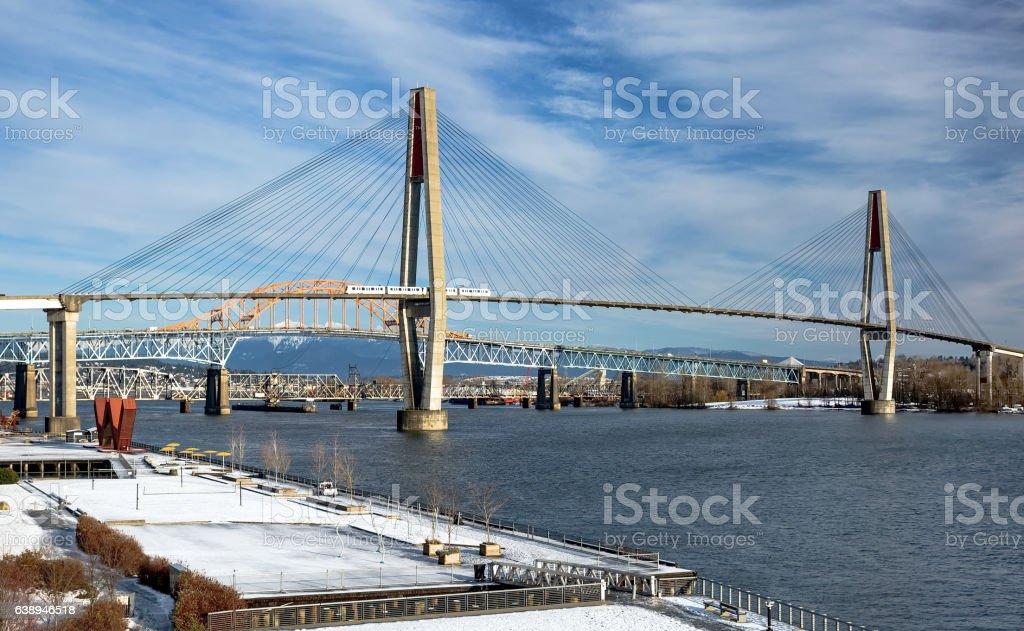 Sky Train Bridge, Pattullo Bridge and Railroad Track in New Westminster stock photo