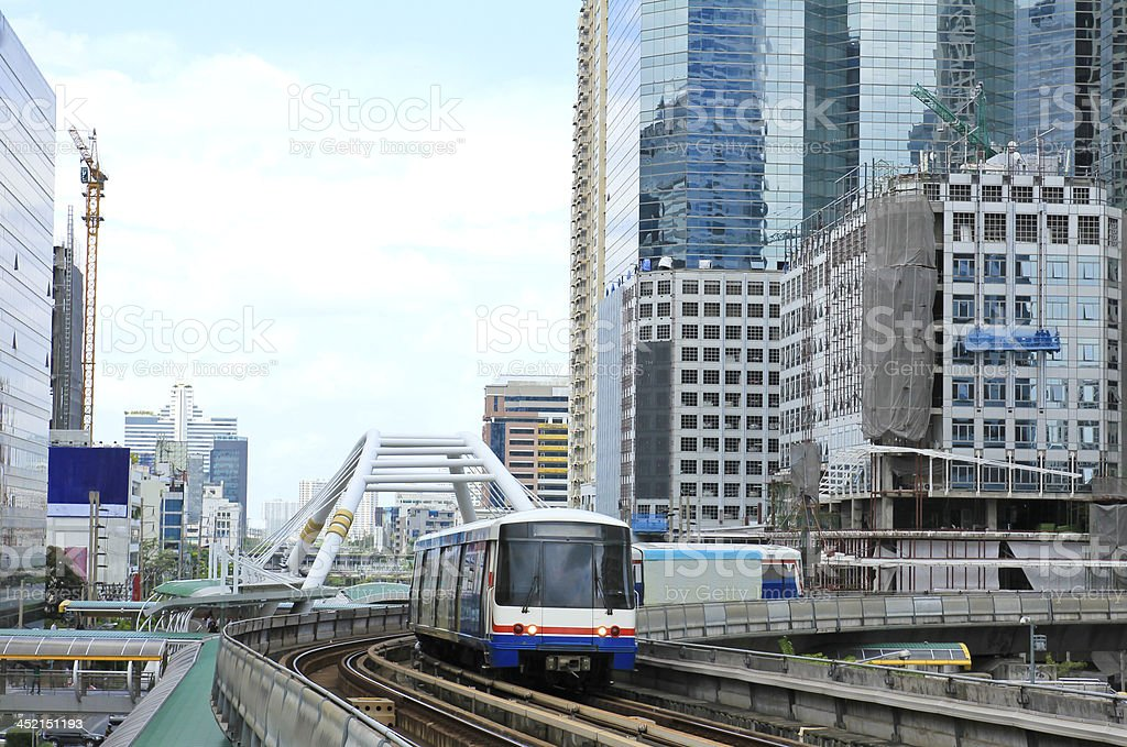 Sky train in Bangkok with business building stock photo