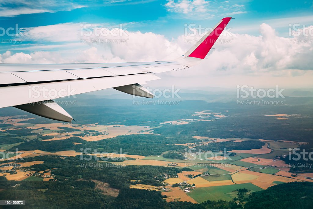 Sky view from airplane window stock photo