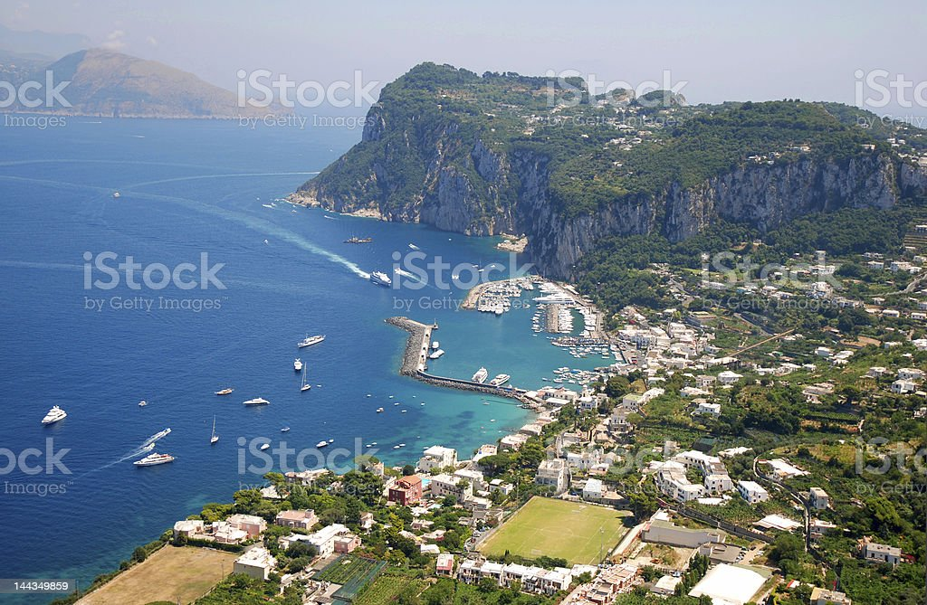 Sky view of coast of Capri with bright blue ocean stock photo