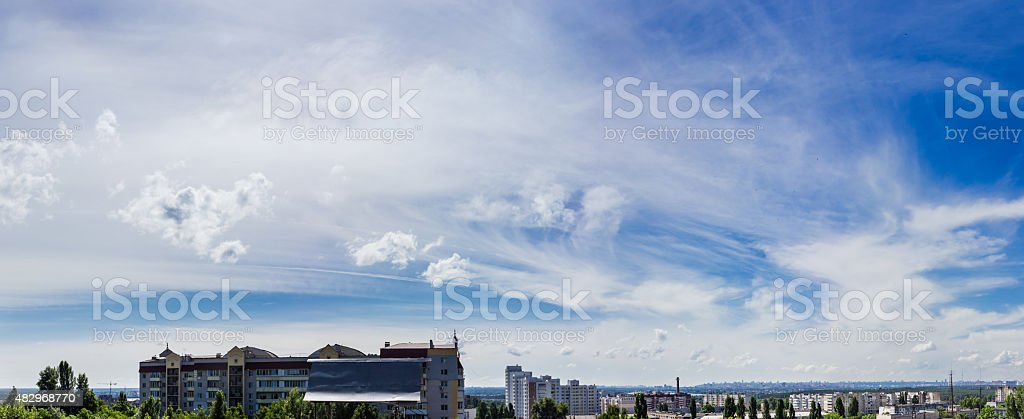 Sky with cirrus cloud against the backdrop of the city stock photo