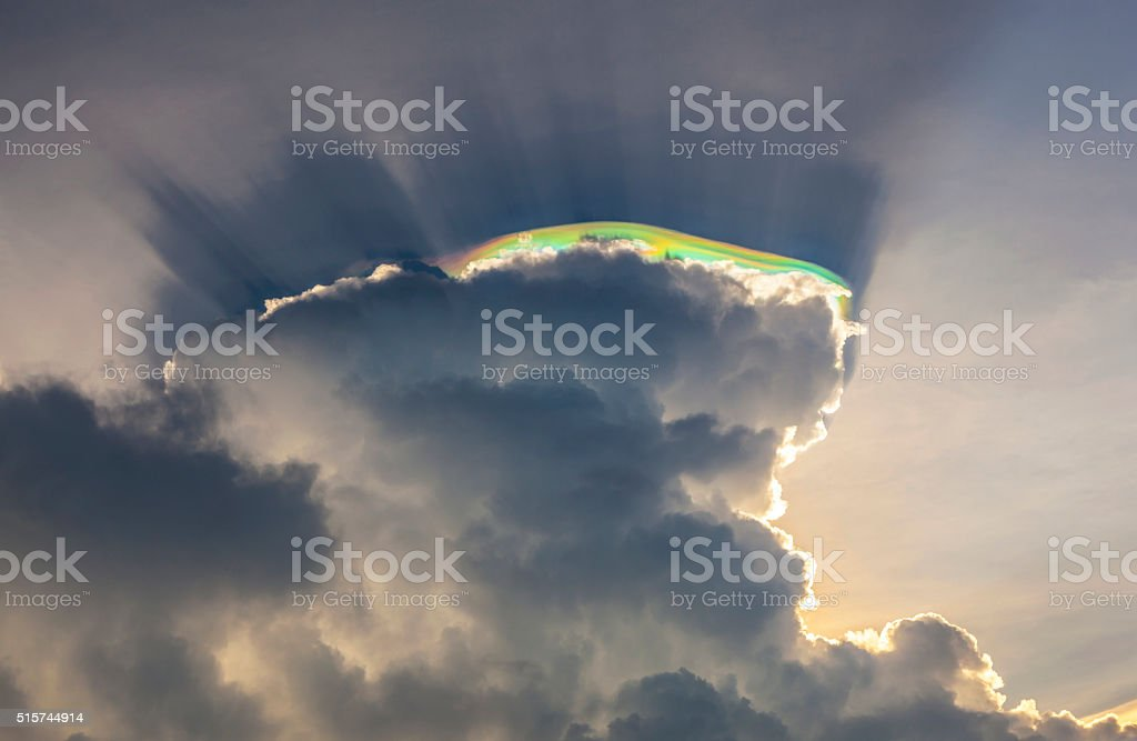 sky with clouds and colorful prisma light reflections stock photo