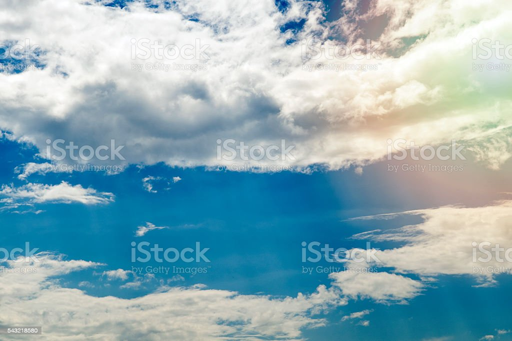 Sky with clouds and sun stock photo