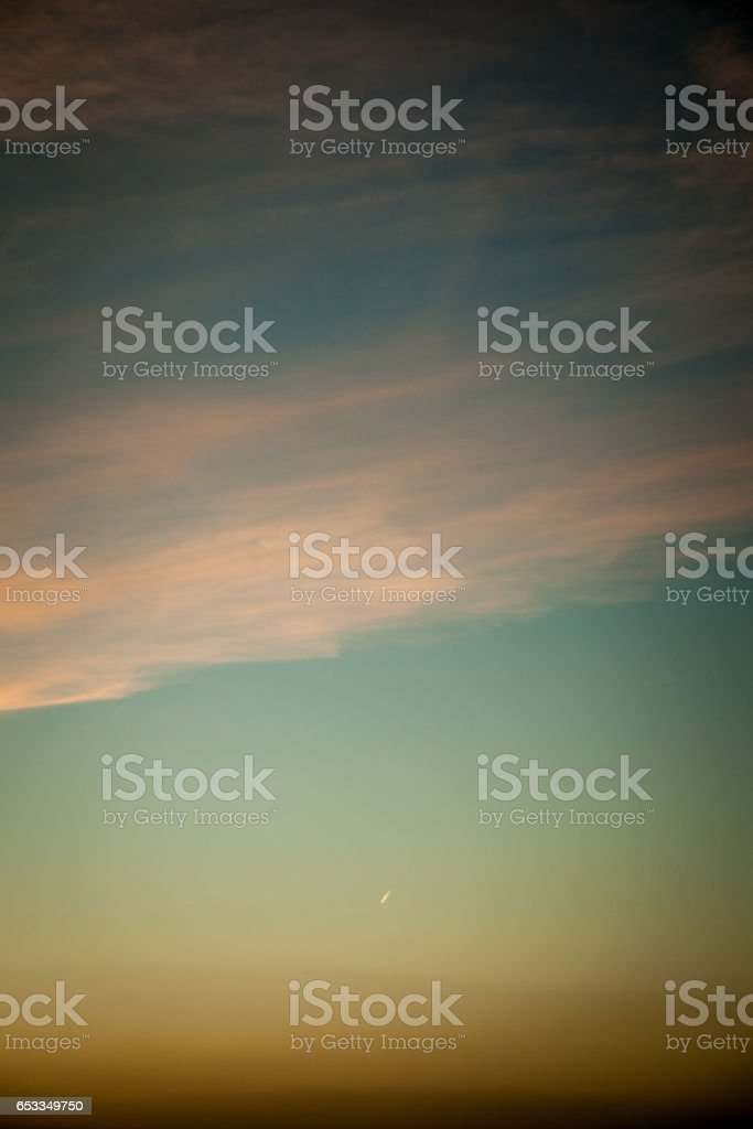 sky with light clouds and a heavy vignette stock photo