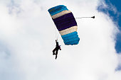 Skydiver and colorful parachute
