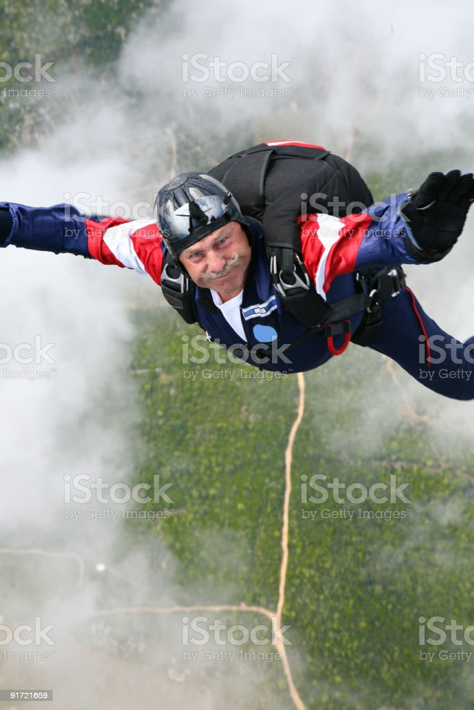 Skydiver in a cloud stock photo