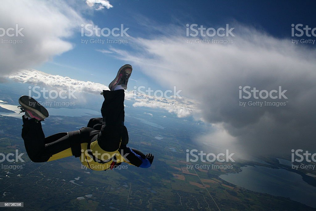 Skydiver in a cloudy sky - skydive royalty-free stock photo