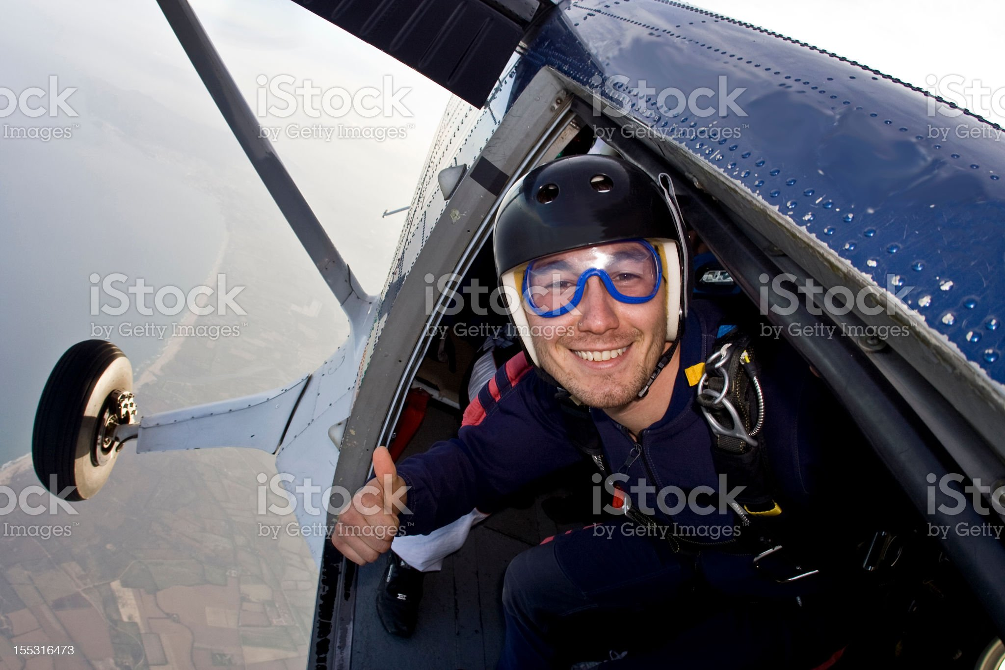 Skydiver in the door of a plane  royalty-free stock photo