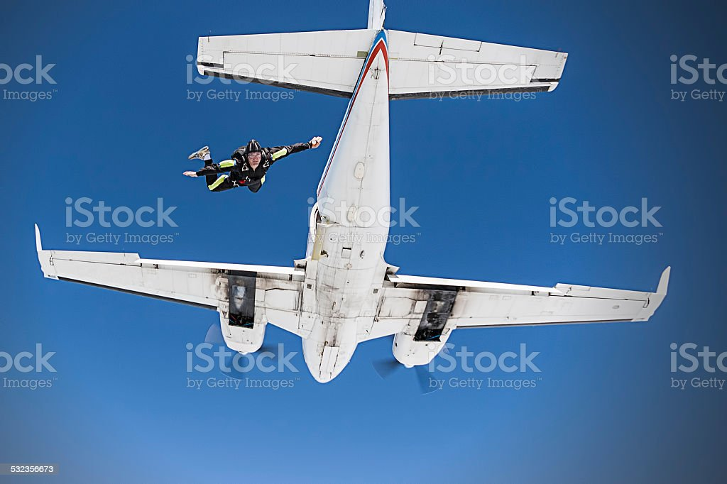 Skydiver jumping from an airplane stock photo