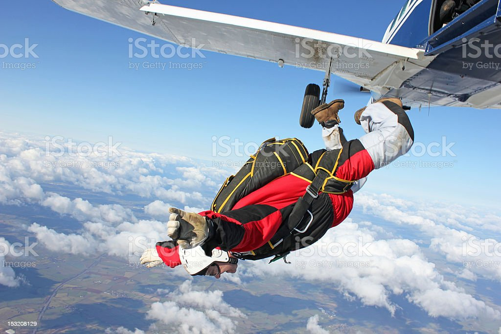 Skydiver jumps from an airplane stock photo