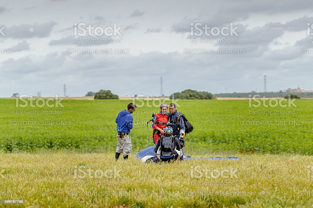 Skydiver Taking a Picture of Tandem after landing foto royalty-free