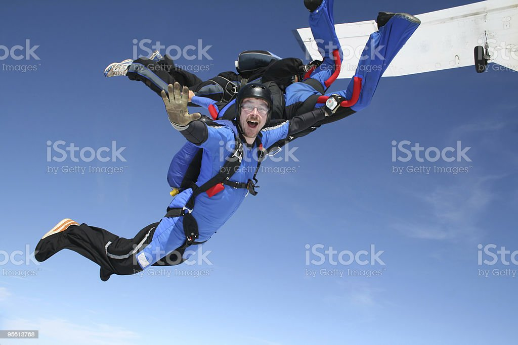 Skydiver waves at the camera stock photo