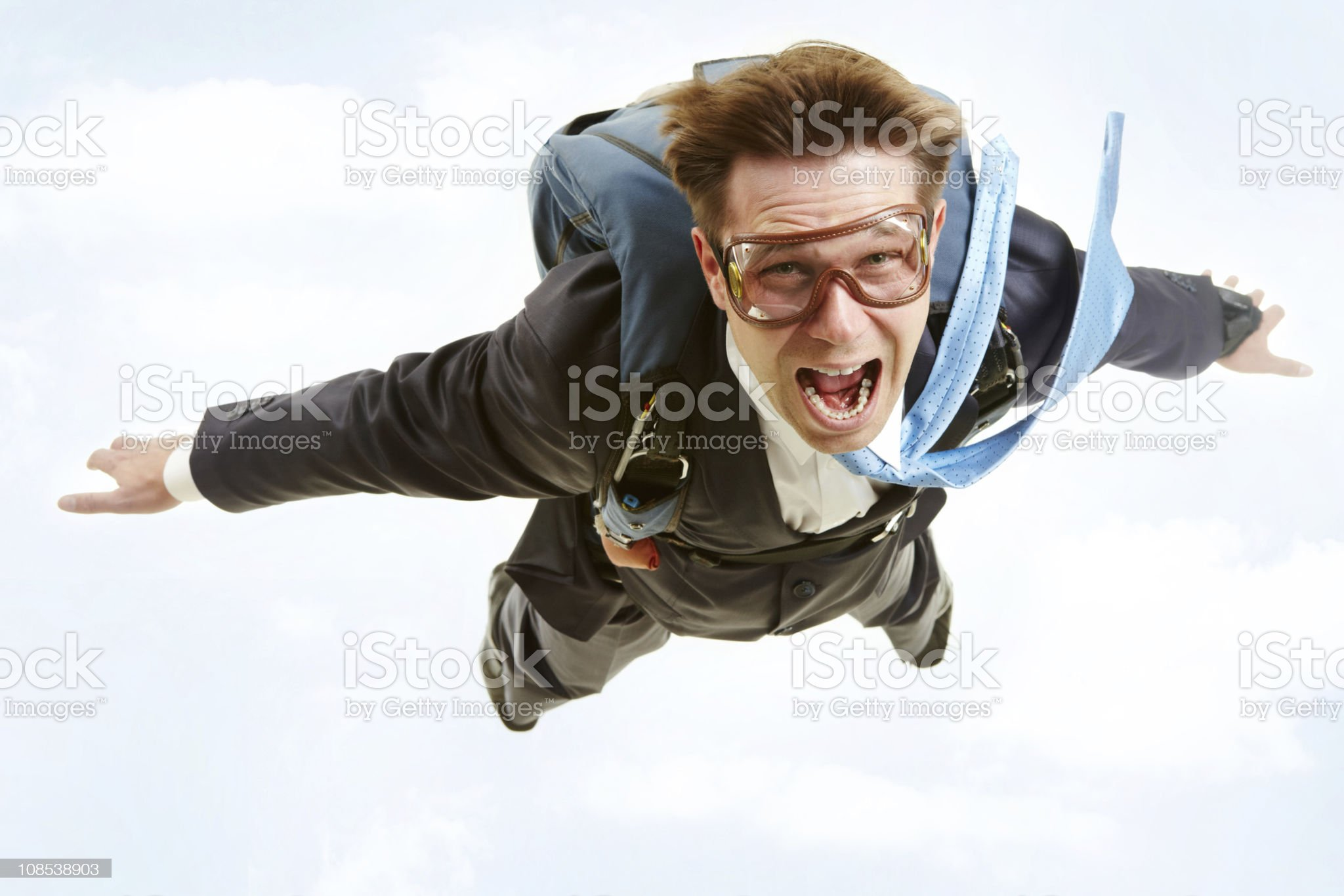 Skydiving man in business suit and goggles royalty-free stock photo