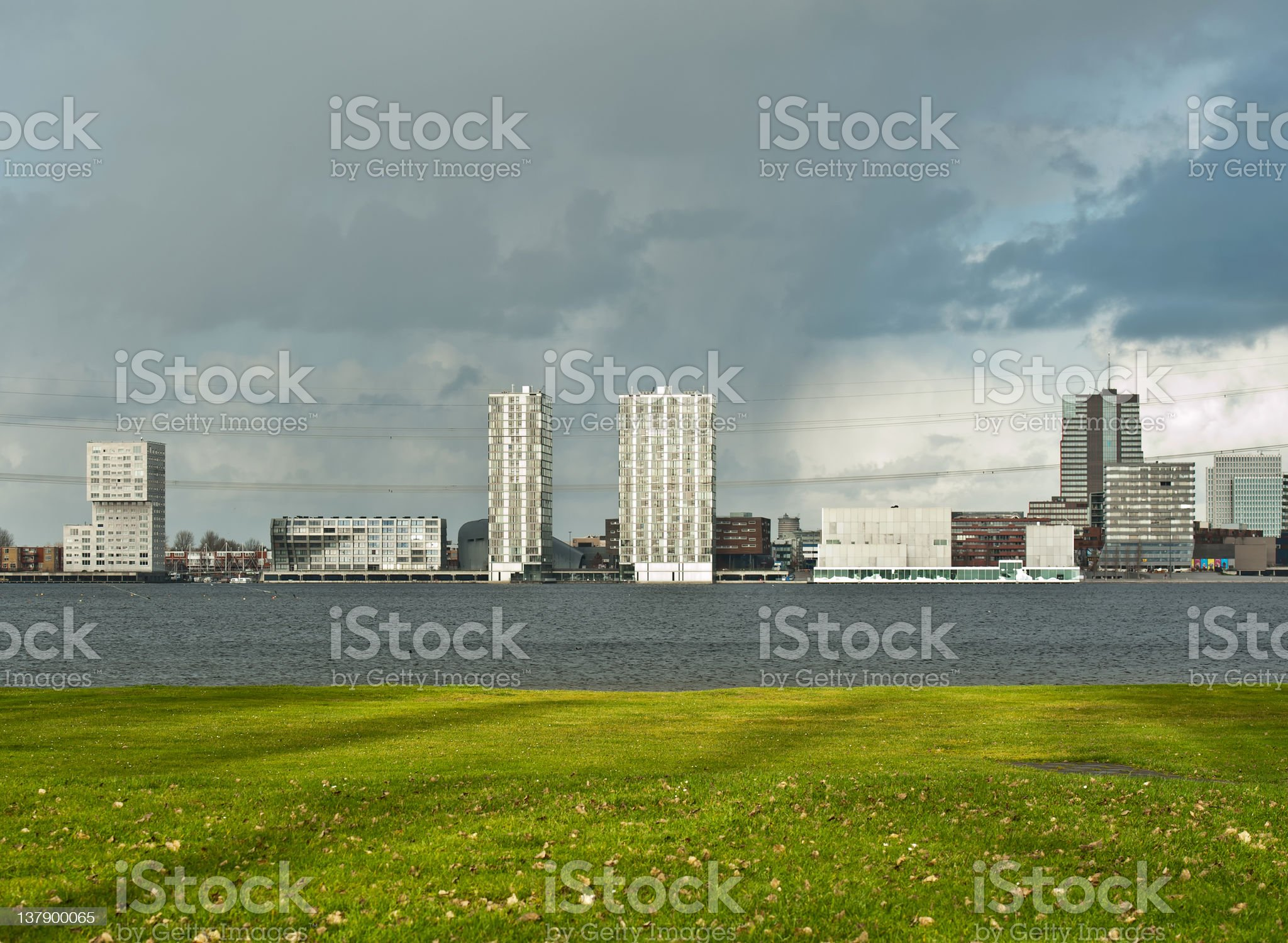 Skyline along a lake and deteriorating weather royalty-free stock photo