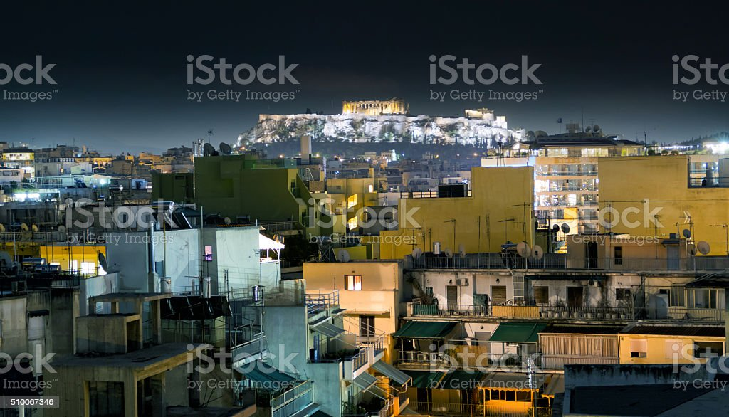 Skyline ancient city of Athens and Acropolis hill by night stock photo